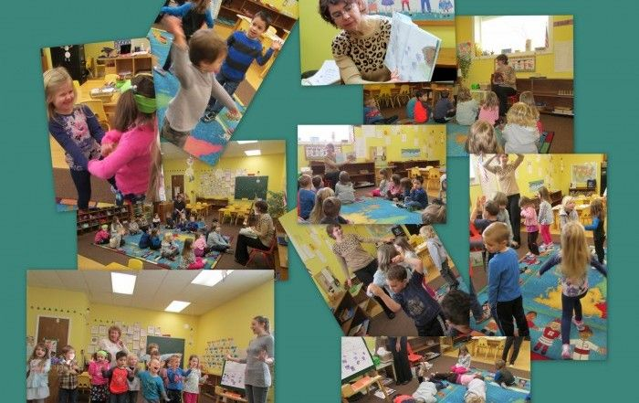 Preschool and Pre-K students enjoying a guest reader, Mrs. Rand
