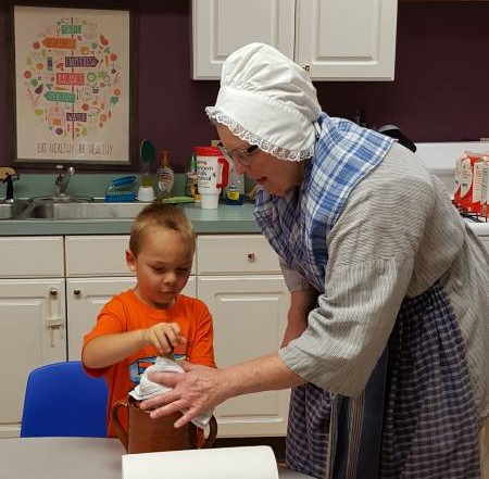 Making Butter - Colonial Times Week at Brookeside Montessori Summer Camp