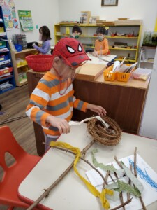 Student creating a scarecrow