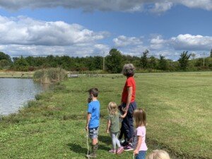 A Walk to the Pond - Students and Teacher Stand on the Shore